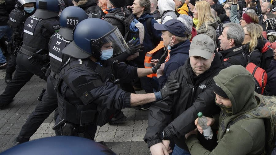 Police forces clash with protesters in Kassel, Germany, March 20, 2021.