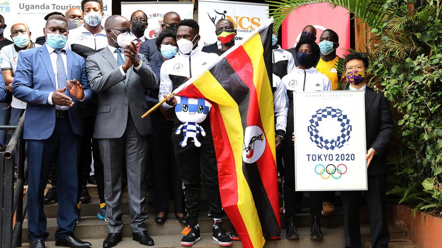 The Uganda Olympic boxing team, with officials including Mizumoto Horii, deputy head of mission for Japan in Uganda, flag off the squad in Kampala before flying to Tokyo on June 17. Now a member of the entourage has tested positive upon landing